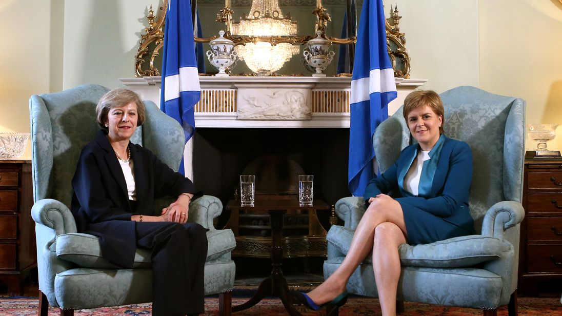 Nicola Sturgeon and Theresa May in July