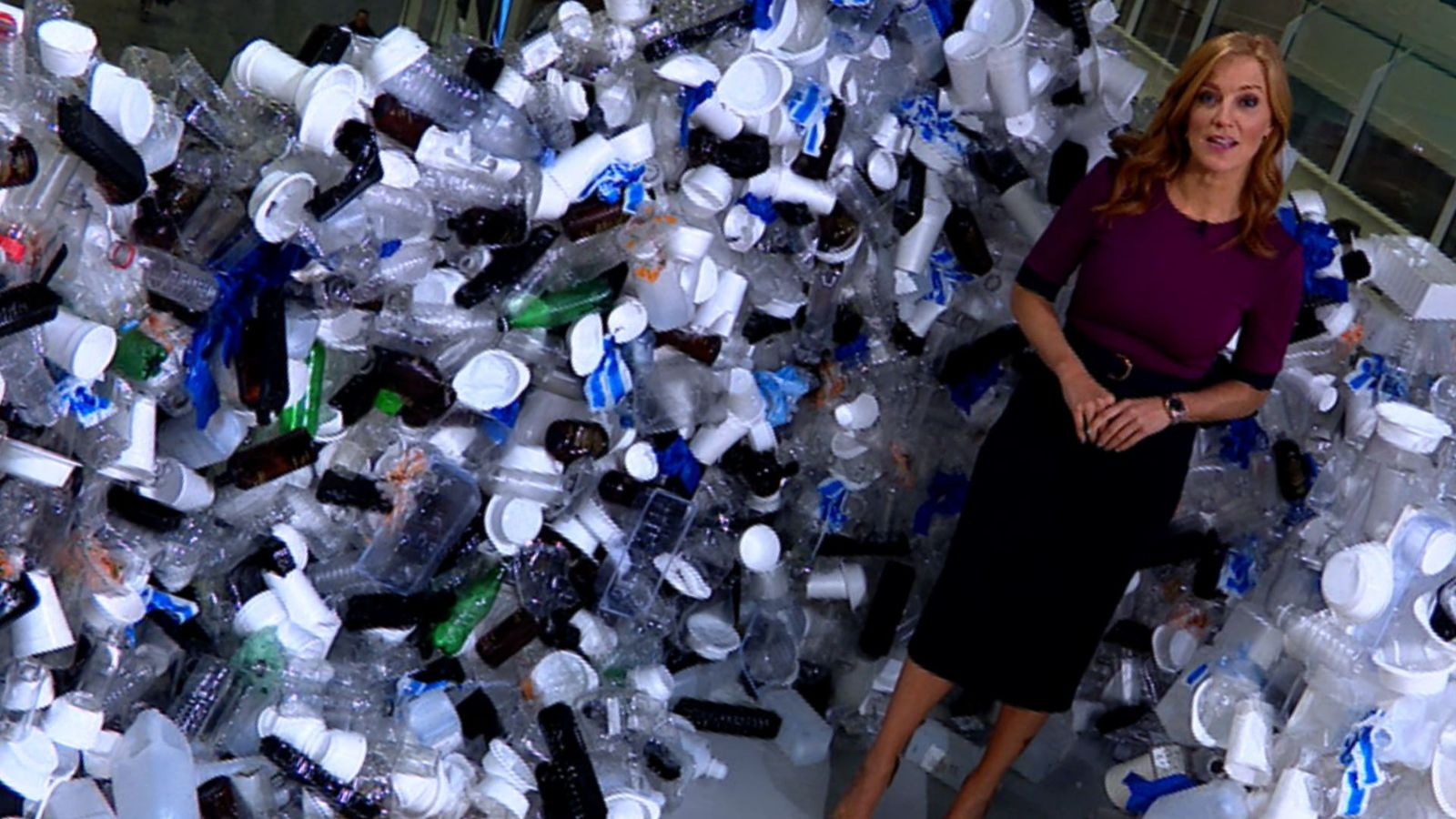 Sky's Sarah-Jane Mee surrounded by plastic waste