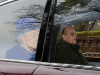 The Queen and the Duke of Edinburgh arrive at Church in Sandringham