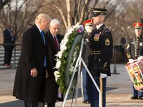 US President-elect Donald J. Trump and US Vice President-elect Mike Pence participate in a wreath laying ceremony at Arlington National Cemetery on January 19, 2017 in Arlington, Virginia
