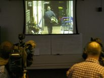 Police show the media CCTV footage from the Northern Bank robbery in January 2005