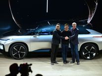 Richard Kim, Jia Yueting and Nick Sampson unveil the FF91