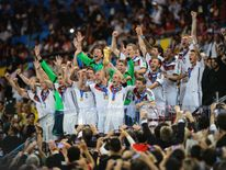 Philipp Lahm of Germany lifts the World Cup trophy with teammates after defeating Argentina 1-0 during the 2014 FIFA World Cup final in Brazil