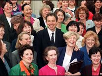 Tony Blair in 1997 with some of the 101 Labour women MPs elected