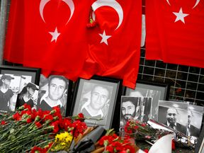 Flowers and pictures of the victims are placed near the entrance of Reina nightclub,