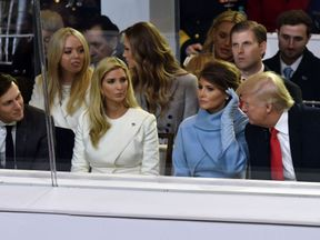 Donald Trump and family watch the inauguration parade
