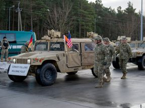 US soldiers are given a welcome ceremony on the Polish border at Olszyna