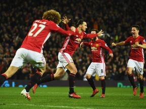 Zlatan Ibrahimovic of Manchester United (2L) celebrates with team mates