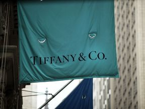 A flag for a Tiffany & Co store hangs along Wall Street