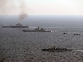 Admiral Kuznetsov (left) is returning to Russia after taking part in the Syrian conflict