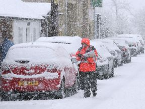 A postman out in the snow in Braco, near Stirling
