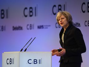 British Prime Minister Theresa May addresses delegates at the annual Confederation of British Industry conference in central London, on November 21, 2016