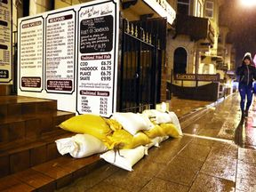 Sandbags outside a restaurant near the seafront in Great Yarmouth, Norfolk,
