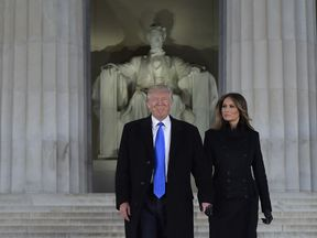 Mr Trump and his wife at the Lincoln Memorial