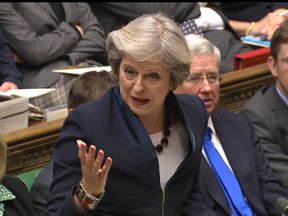 Theresa May answers questions from MPs in the Commons