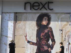 Shoppers pass a branch of Next retail in London, Britain November 2016