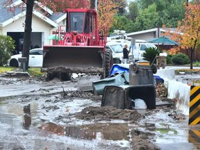 A bulldozer clears mud in Duarte, California, after a heavy storm on 16 December