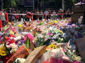 Flowers have been left in Bourke Street ahead of a vigil on Monday