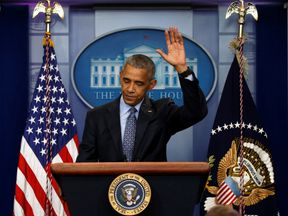 US President Barack Obama waves goodbye at the conclusion of his final press conference
