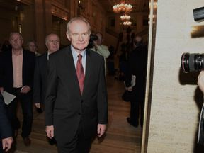 Martin McGuinness walks through the Great Hall at Stormont
