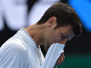 Defending champion stunned by wild card at Australian Open