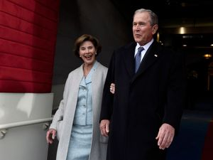 George W Bush: 'We all need answers' on Trump-Russia links