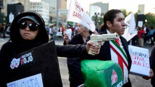 People protest demanding the resignation of President Enrique Pena Nieto