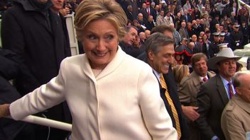 Hillary Clinton put on a brave face watching Donald Trump become President