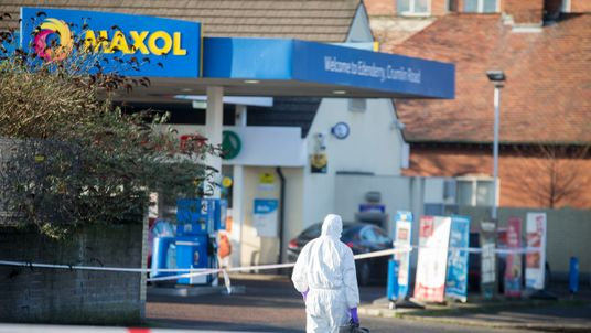 A forensic officer attends the scene at Edenderry Filling Station, Crumlin Road Belfast where a PSNI officer was shot last night. PRESS ASSOCIATION Photo. Picture date: Monday January 23, 2017. See PA story ULSTER Shooting. Photo credit should read: Liam McBurney/PA Wire  A forensic officer at the scene of Sunday nights shooting