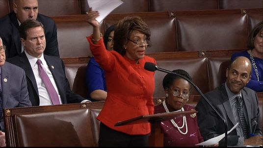 U.S. Representative for California's 43rd congressional district, Maxine Waters, asks for a Senator's signature on a written objection to Donald Trump's presidential election victory.