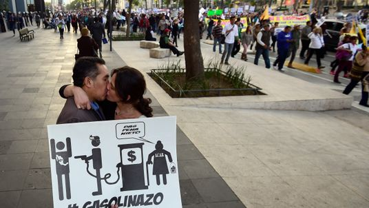 A couple kiss during a protest demanding the resignation of President Enrique Pena Nieto