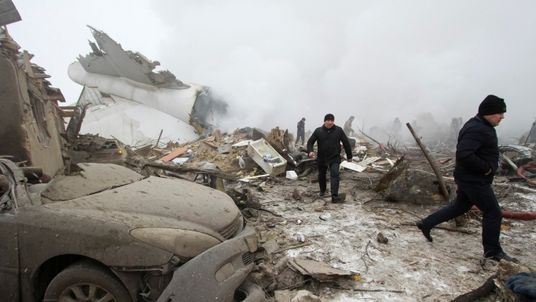 Plane debris is seen at the crash site of a Turkish cargo jet near Kyrgyzstan's Manas airport outside Bishkek, January 16, 2017.