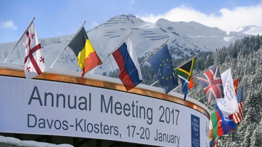 Flags welcome people to the Davos World Economic Forum