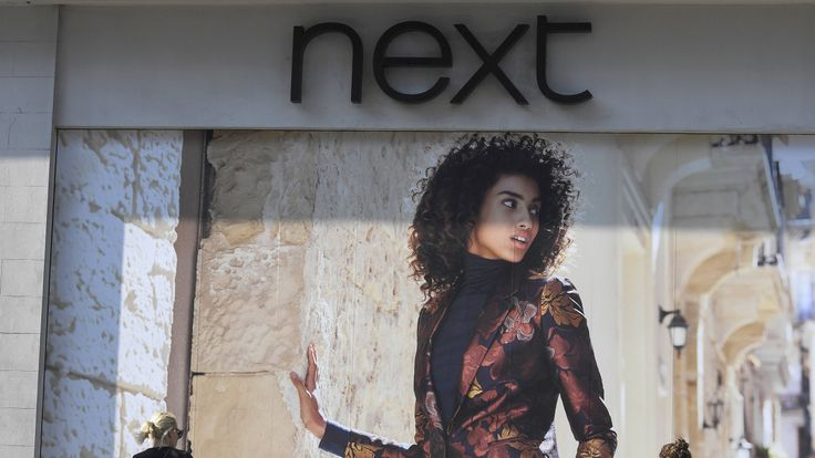 Next profits fall for first time in eight years
