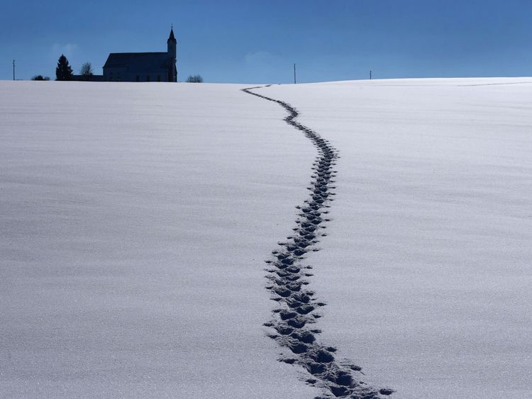 Footprints leading to the Sankt Alban pilgrimage church in southern Germany