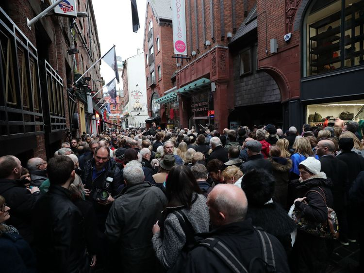 A crowd waits for the unveiling of the statue of Cilla Black in Liverpool