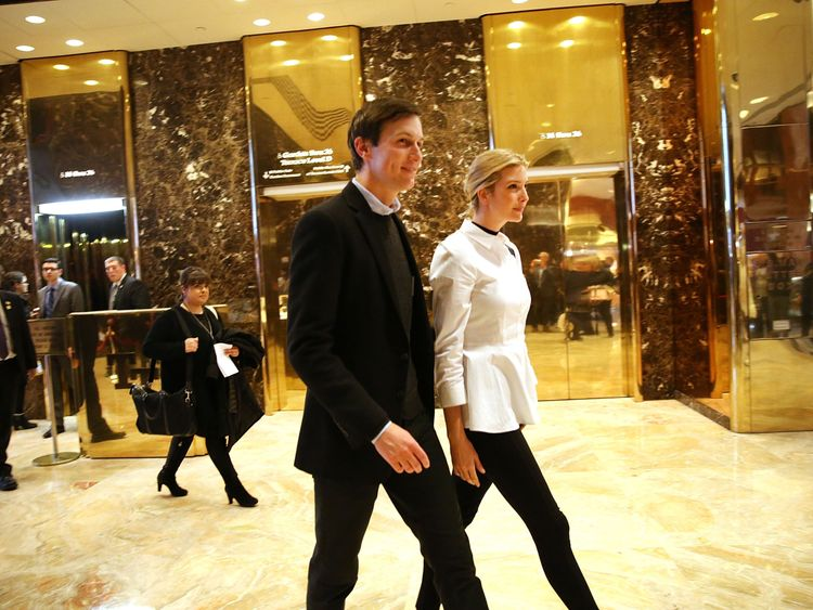 Jared Kushner with his wife Ivanka in the lobby of Trump Tower