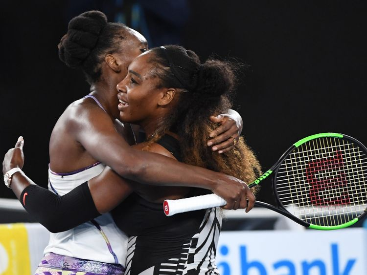 Serena and Venus hug after the Australian Open final