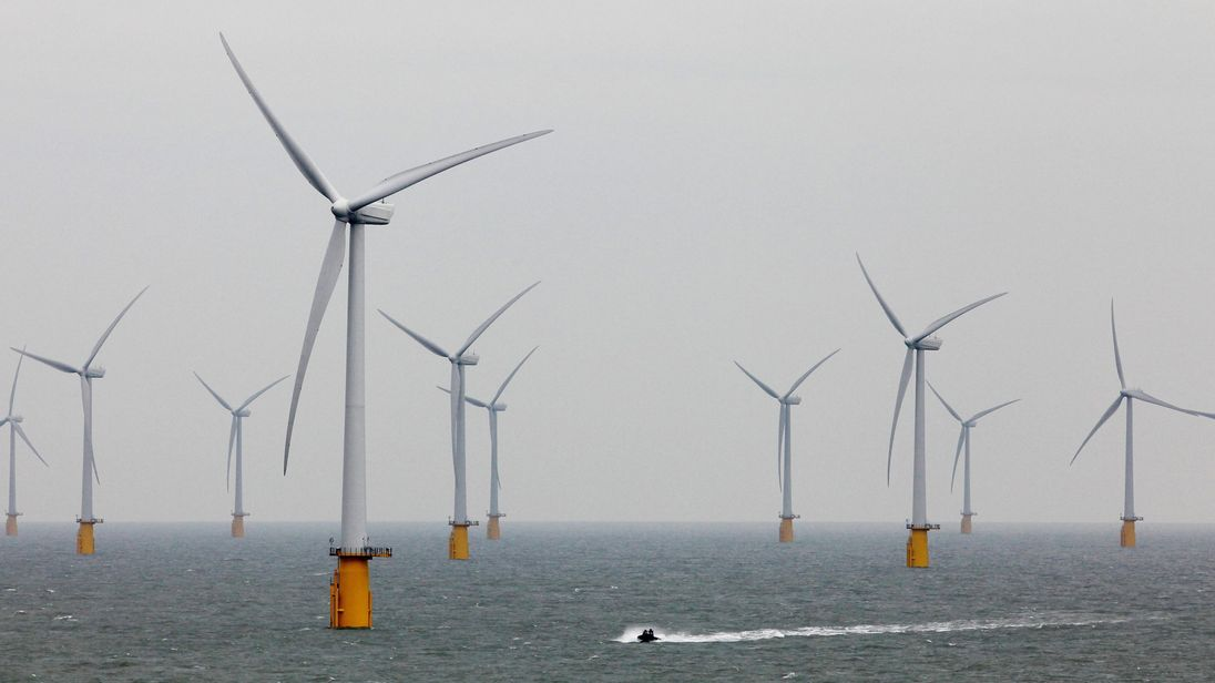 "File photo dated 23/09/10 of an offshore wind farm, as consumers will be hit with higher bills because officials ""significantly underestimated"" the cost of green energy schemes, the Commons spending watchdog has found"