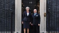 Theresa May greets Bernard Cazeneuve as he arrives in Downing Street