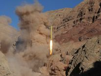 Iran has said test-firing a ballistic missile does not breach the terms of a deal on its nuclear programme