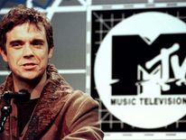 Robbie Williams speaks at a press conference October 10 announcing that he will host the 1996 MTV Europe Music Awards in London November 14