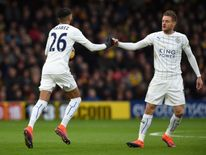 By November, the form of Jamie Vardy and Riyad Mahrez propelled Leicester to the top end of the table