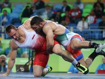 Iran's Reza Yazdani competes in the Rio Olympics. The country has banned US wrestlers from a competition
