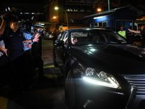 A North Korean embassy official leaves Kuala Lumpur General hospital