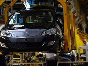 Vauxhall and Opel Astras are constructed on the production line in the Vauxhall factory in Ellesmere Port, north-west England