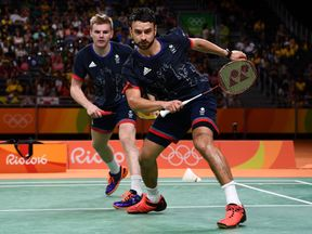 RIO DE JANEIRO, BRAZIL - AUGUST 18: Chris Langridge and Marcus Ellis of Great Britain returns a shot against Wei Hong and Biao Chai of China during the Men's Doubles Badminton Bronze Match on Day 13 of the Rio 2016 Olympic Games at Riocentro - Pavilion 4 on August 18, 2016 in Rio de Janeiro, Brazil. (Photo by David Ramos/Getty Images)