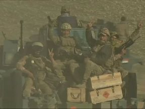 Iraqi forces taking part in the assault on Mosul airport