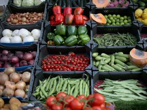 Fruit and vegetables are displayed for sale at a grocers shop on May 23, 2014 in London, United Kingdom. Researchers at University College London recently said that eating 'five-a-day' of fruit and vegetables should be increased to seven. The study involving 65,226 men and women concluded that lifestyles which included at least seven-a-day reduced the chances of serious health issues