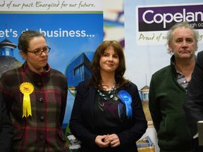 Tory candidate Trudy Harrison (C) smiles after winning the Copeland by-election